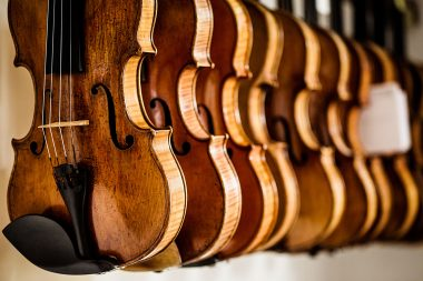Row of violins at J & A Beare in London