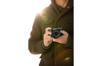 Advertising lifestyle photograph of a man holding a camera