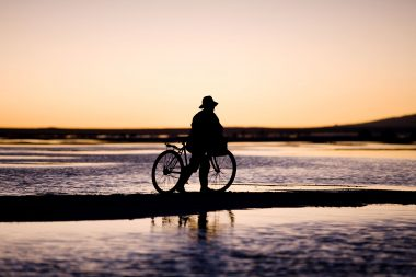 Photograph of a cyclist in the landscape for Sony
