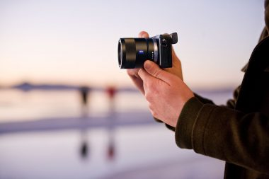 Advertising image of hands holding a camera