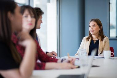 Woman in a boardroom setting corporate image