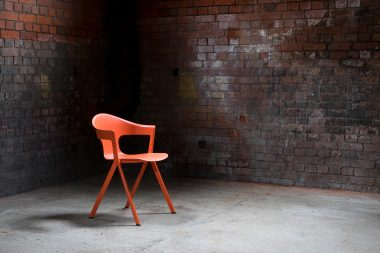 An orange chair photographed in an abandoned power station
