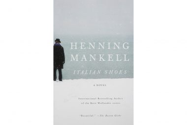 A man on a beach on the cover of the Henning Mankell novel Italian Shoes