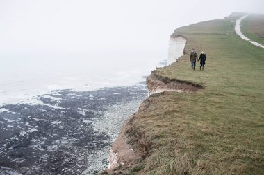 A couple walking on a cliff photographed for an advertising photograph