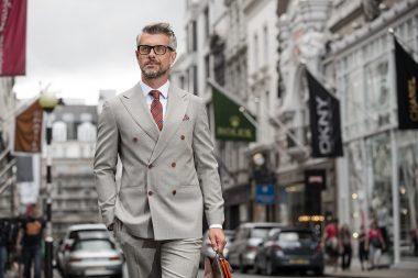 A man walking down Bond Street in London