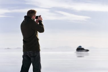 A man taking a photograph of a car photographed for Sony for an advertising campaign