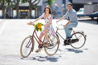A man and a woman cycling for a lifestyle photograph