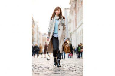A woman walking on a street in London