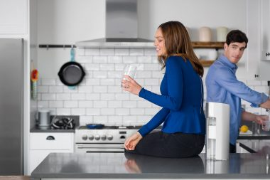 Lifestyle photograph of a woman in a kitchen
