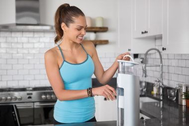 A woman with a water filter photographed for an advertising campaign