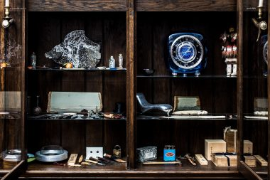 A photograph of the cabinet of curiosities of Marc Newson for Habitus Magazine