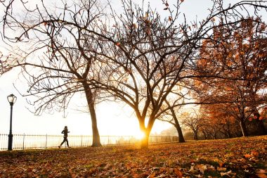 A woman running in Central park New York