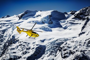 Yellow helicopter in the French Alps