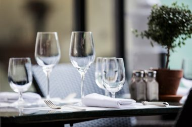 Photograph of wine glasses on a restaurant table in London