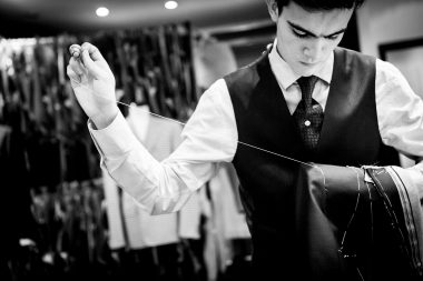 Photograph of a Savile Row tailor sewing a mens jacket