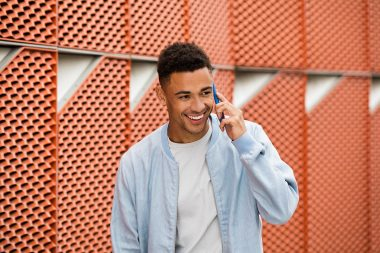 Lifestyle-photograph-of-man-on-mobile-phone