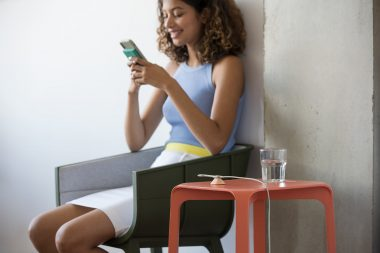 lifestyle-photography-of-woman-sat-at-home-with-phone