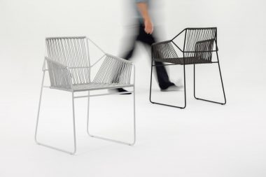 man-walking-behind-sandur-chairs-in-london