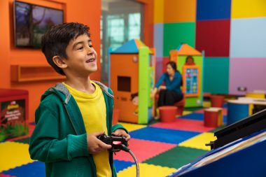 advertising-photograph-of-boy-playing-video-game