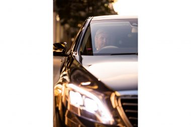 photograph-of-wheely-chauffeur-sitting-in-mercedes-benz-in-london-at-sunset