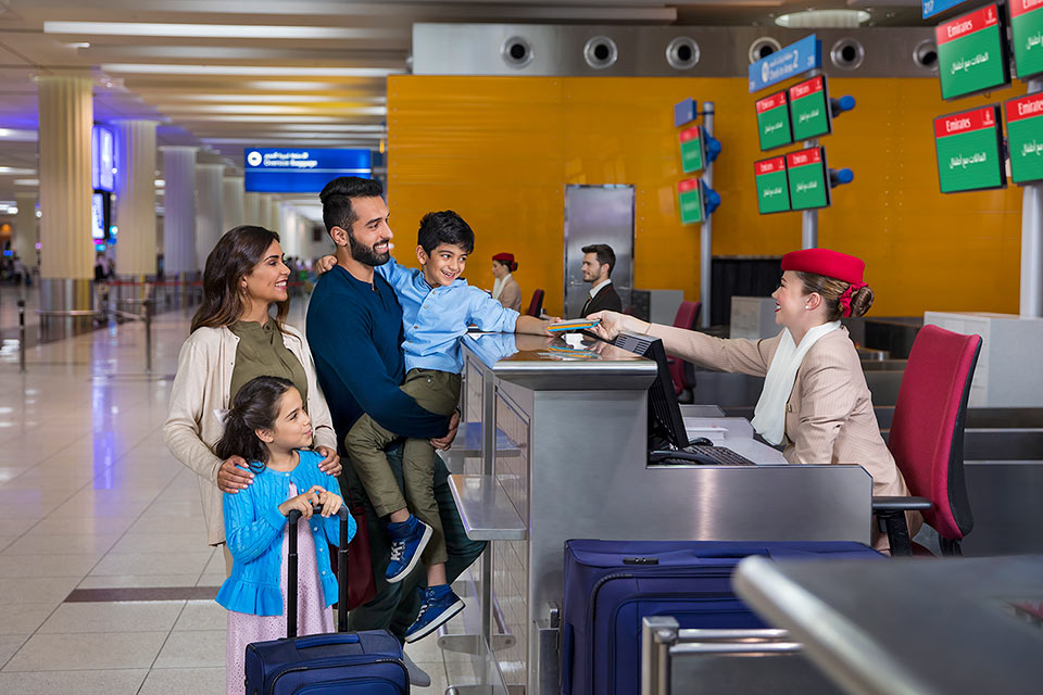 advertising-lifestyle-photograph-of-family-checking-in-in-dubai-airport