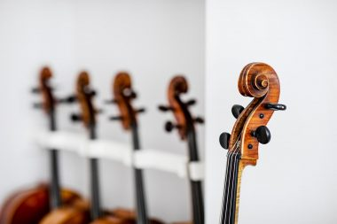 details-of-cellos-in-a-white-room-at-j-and-a-beare-ltd-london