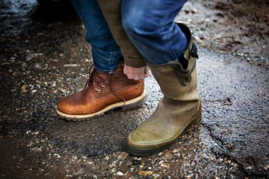lifestyle-photograph-of-man-putting-on-walking-boots-by-richard-boll