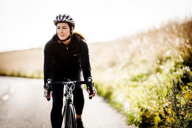 lifestyle-photograph-of-woman-cycling-in-countryside