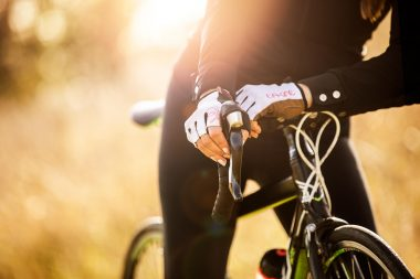 lifestyle-photograph-of-woman-with-cycling-gloves