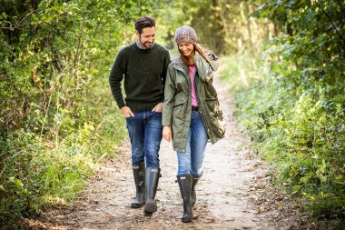 commercial-advertising-photograph-of-couple-walking-in-forest