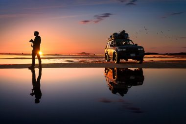 lifestyle-advertising-photograph-of-photographer-with-jeep-in-sunset