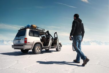 photographer-walking-towards-four-wheeled-drive-vehicle-in-bolivia