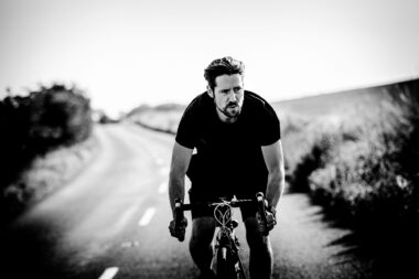 cyclist-on-country-road-in-lifestyle-photograph