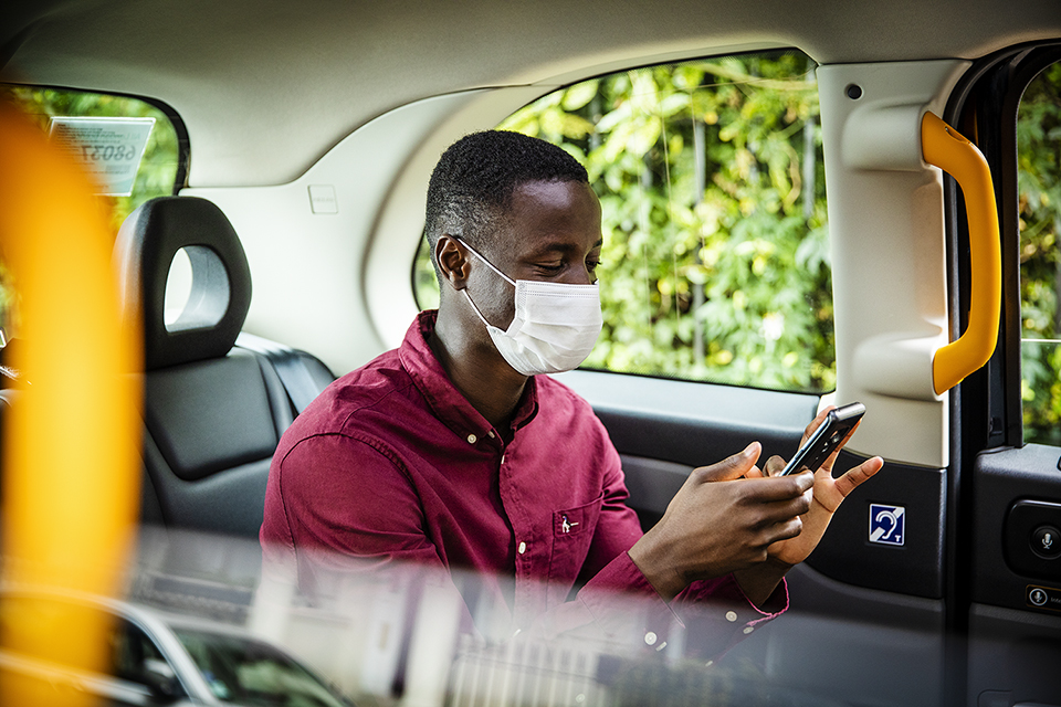customer-in-taxi-with-mask-by-london-lifestyle-photographer