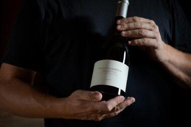 olivier-berstein-holding-a-bottle-of-mazis-chambertin-grand-cru